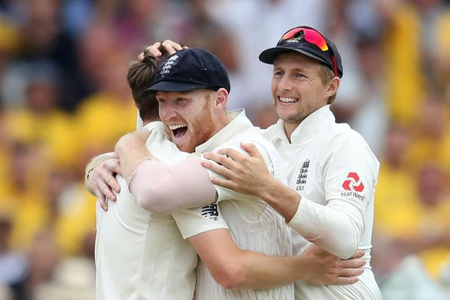 Ben Stokes, centre, will captain England in the absence of Joe Root, right (Tim Goode/PA)