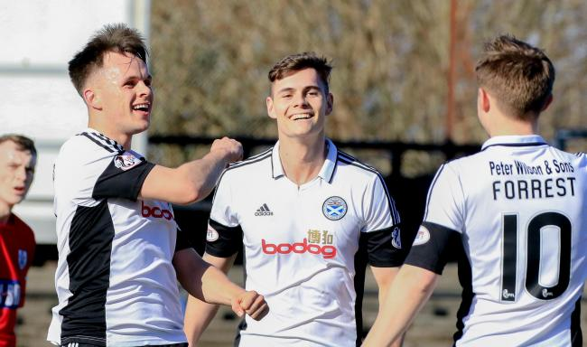 TREBLE TOPPER: Striker Lawrence Shankland (left) celebrates his hat-trick with team-mates in Ayr United's 4-0 win against Queen's Park.