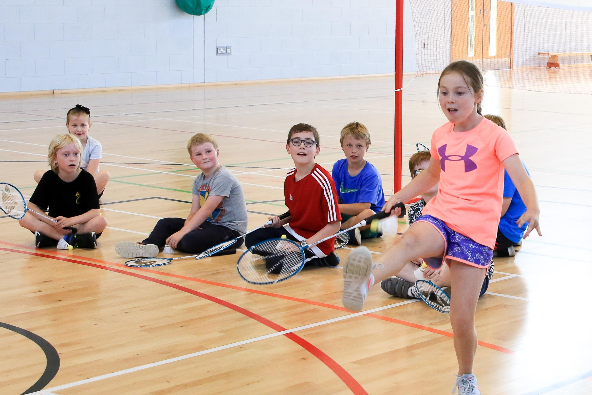 Badminton aces hold court