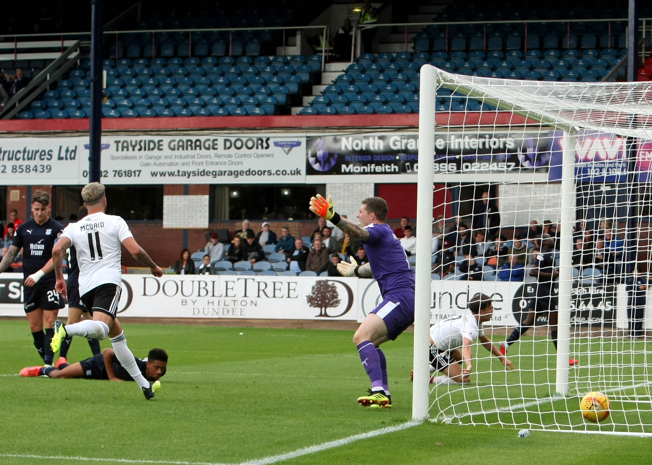 GOAL MACHINE: Lawrence Shankland nets Ayr's second goal. Picture: David Sargent.