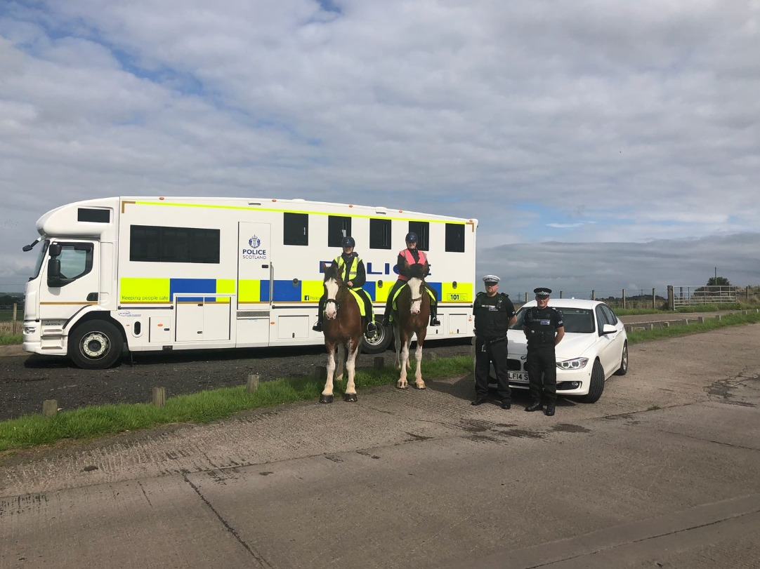 PC Michael Prout from Ayrshire's Road Policing Unit, Sgt Alan Gilbert from Police Scotland's mounted branch, with PC Kirsten Watson riding Police Horse Harris and PC Jill Rumsey riding Police Horse Lewis